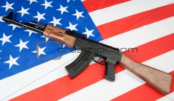 Flag of the United States with a weapon