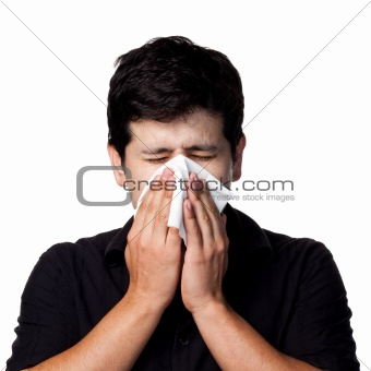 Sneezing hispanic man