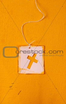 Close up of handmade paper tag with holy cross