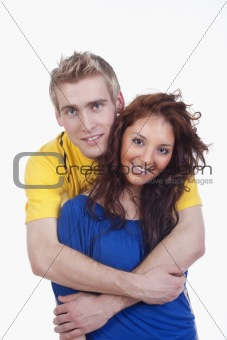 happy young couple - boy embracing girl, smiling - isolated on white