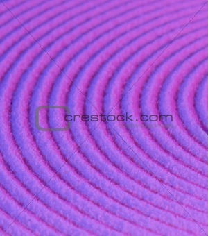 Abstract pattern - concentric circles on purple sand