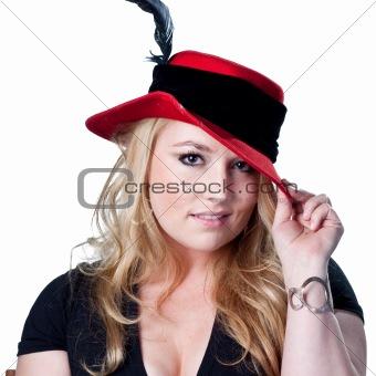 Blonde woman in fancy dress hat