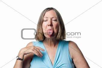 Older woman sticking out her tongue