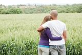 Rear view of couple with arms around each other