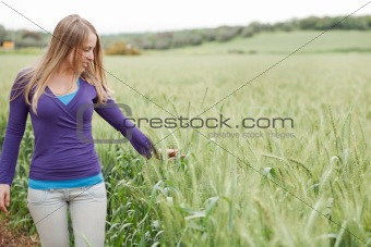 Portrait of lady walking between the grass