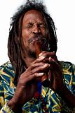 Rastafarian playing the flute
