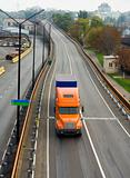 Orange truck on the road overpass