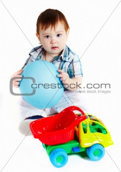 Boy with baloon and toy truck