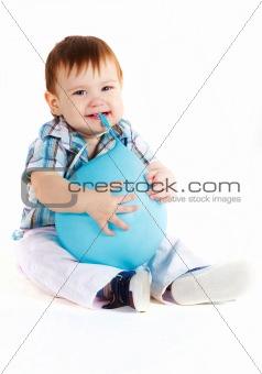 Little boy eats blue baloon