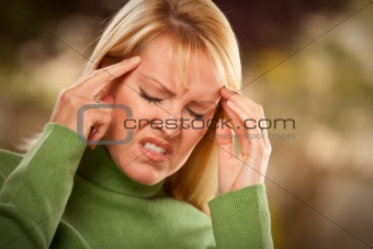 Grimacing Woman Suffering a Painful Headache.