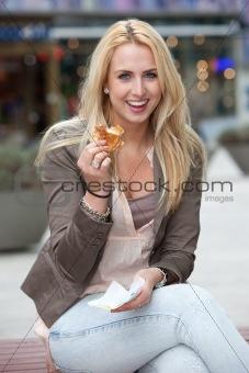 Beautiful girl having a burger