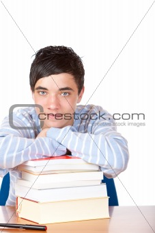 Young happy handsome male student leaning on study books