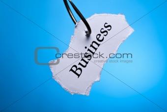 Business on peace of paper pierced in hook