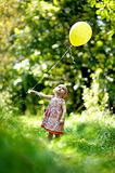 Little baby girl with a yellow balloon