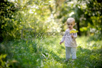Little baby in a summer forest