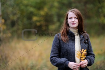 Beautiful young woman in forest