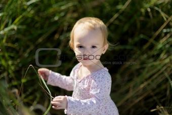 Little baby iin a meadow
