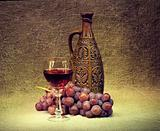 Dark Still Life - clay bottle, glass and grapes