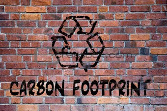 Carbon footprint recycle sign grafitti