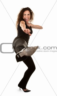 Tough woman in high heels kicking at camera