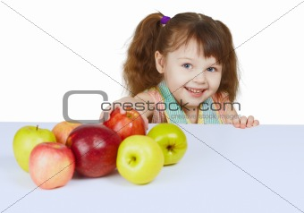 Little cheerful girl with apples