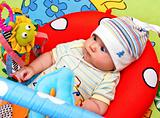 Infant in baby gym