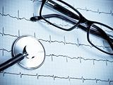 Stethoscope with glasses on EKG
