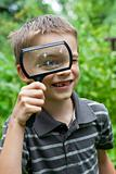 Kid with loupe