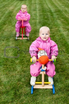 Toddlers on rocking horses