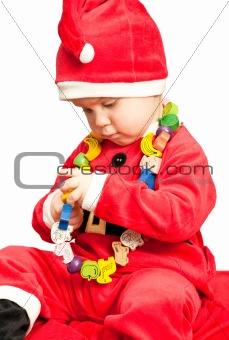 Baby wearing Santa suit