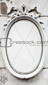 Blank oval frame on a wall