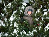 Kid hiding in fir trees