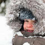 Kid playing in snow