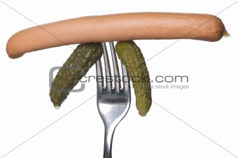 frankfurter and cucumber on fork
