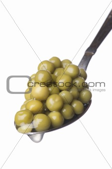 green peas on spoon