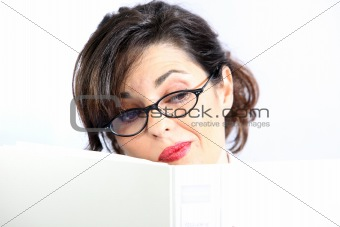 A young woman hides behind a folder / book