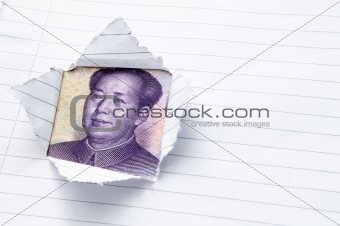 Lined paper torn with window opening showing Chinese currency