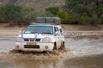 Crossing of a river by 4x4 in Namibia - Kaokoland