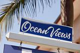 Ocean Views Real Estate Sign in Front of House.