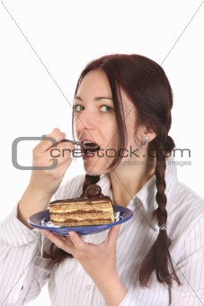Beautiful woman eating piece of cake