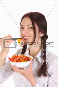 Beautiful woman eating with chopsticks