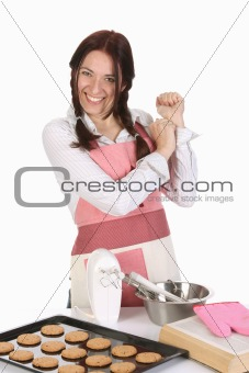 beautiful housewife with completed cakes