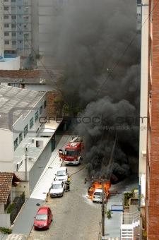Car on fire with fireman