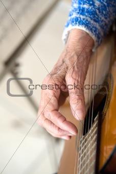 Old hands on guitar