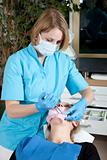 Female dentist working on her patient