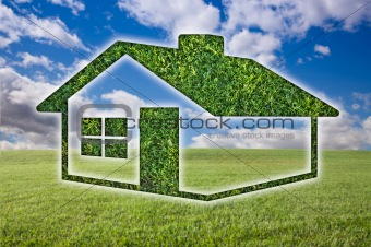 Green Grass House Icon Over Field, Blue Sky and Clouds.