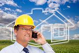 Contractor in Hardhat on His Cell Phone Over House Icon, Empty Grass Field and Deep Blue Sky with Clouds.