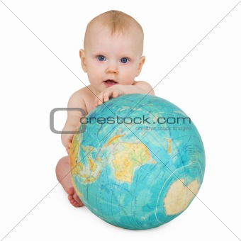 Baby sitting on white background with globe