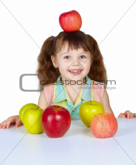Little girl placed apple on head