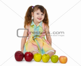 Little girl and train of apples